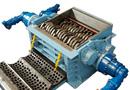 Déchiqueteur de déchets à cisaille rotative 3 axes avec grille de calibrage par Decoval Engineering